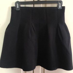 Black fleece like skirt with pleats